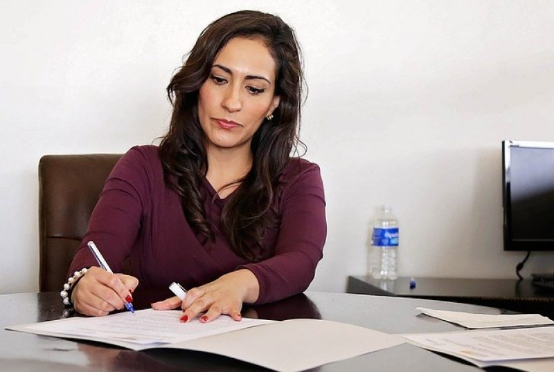Woman working on document collection