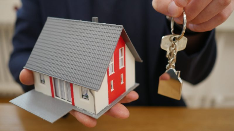 House in hand with keys