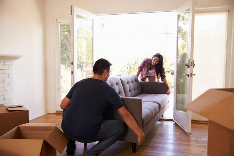 Couple moving in their couch