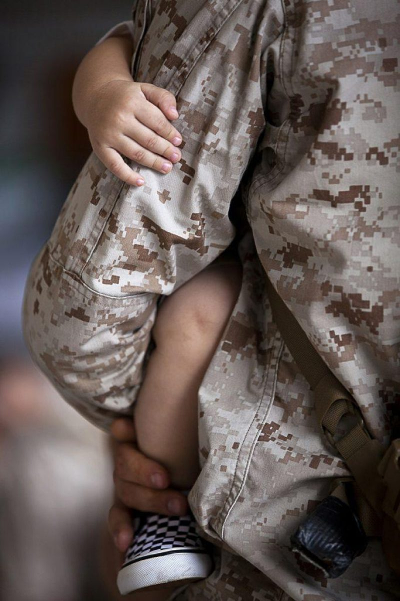 Solider holding baby; VA loan eligibility and benefits