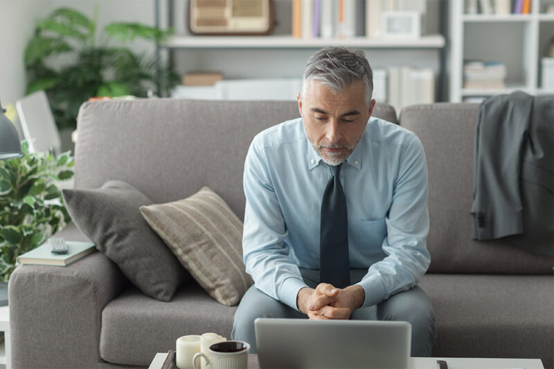 Man working from home at coffee table